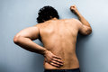 Young man with severe back pain from sciatica is barely able to move Royalty Free Stock Photos