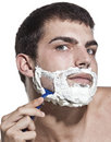 image photo : Young man shaving