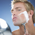 A young man shaving Royalty Free Stock Photo