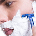 Young man shaving the  beard with the razor Stock Image