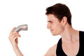 Young man shaving his beard off with an electric razor isolated Royalty Free Stock Photos