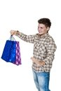 Young man with shopping bags isolated on white Royalty Free Stock Images