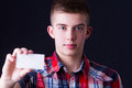 Young man showing blank business card Royalty Free Stock Photo