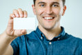 Young man showing blank business card or sign Royalty Free Stock Photo