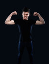 Young man showing his muscles Royalty Free Stock Photo