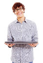 Young man showing laptop smiling college student holding closed isolated on white background mask included Royalty Free Stock Photography