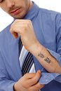 Young man showing tattoo in forearm businessman unbuttoning shirt small Stock Photo