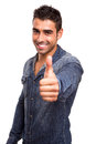 Young man showing thumbs up portrait of a Royalty Free Stock Photography