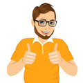 Young man showing thumbs up sign portrait of positive with glasses with both hands isolated on white background Stock Image
