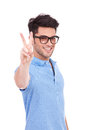 Young man showing victory sign Royalty Free Stock Image