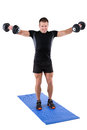 Young man shows finishing position of dumbbell Royalty Free Stock Photo