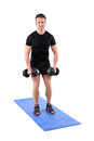 Young man shows starting position of dumbbell Royalty Free Stock Photo