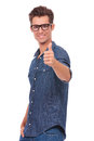 Young man shows thumb up Stock Photography