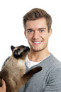 Young man with siamese cat a love of animals Stock Photography