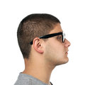 Young man side profile a teenage isolated over white wearing black frame nerd type vintage glasses Stock Photography
