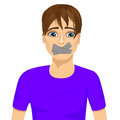 Young man silenced with wouth covered with grey duct tape Royalty Free Stock Photo