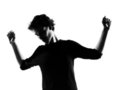 Young man silhouette dancing happy Stock Photography