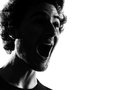 Young man silhouette happy screaming Royalty Free Stock Photo
