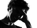 Young man silhouette headache sadness Royalty Free Stock Photos