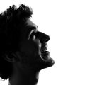 Young man silhouettes miling happy Royalty Free Stock Photo