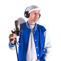 Young man singing in the studio with microphone and headphones over white Stock Photography