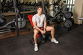 Young man sits after workout in gym Stock Photo