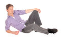Young man sitting on floor a handsome in jeans and a checkered shirt the looking away isolated for white background Stock Photos