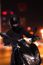 Young man sitting on his motorcycle at night in beijing Stock Photos