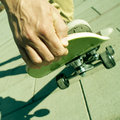Young man skateboarding closeup of a performing a trick with his skate Royalty Free Stock Photography
