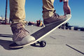 Young man skateboarding closeup of a performing a trick with his skate Royalty Free Stock Photos