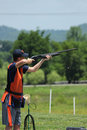Young man skeet shooting with airborne shell trap Stock Photo