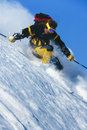 Young man skiing powder snow in mountains in winter st anton austria Royalty Free Stock Images