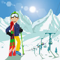 Young man with skis and poles standing in front of mountains with ski chair lift and bright sun in ski resort