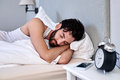 Young man sleeping peaceful with beard comfortably in bed at home Stock Image