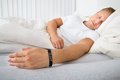 Young Man Sleeping Wearing Sma...