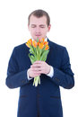 Young man smelling bunch of tulips isolated on white Royalty Free Stock Photography