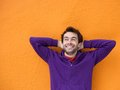 Young man smiling with hands behind head Royalty Free Stock Photo