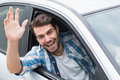 Young man smiling and waving Royalty Free Stock Photo