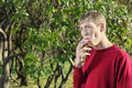 Young man smokes in park Royalty Free Stock Photo