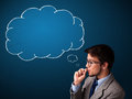 Young man smoking cigarette with idea cloud Royalty Free Stock Photo