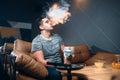 Young man smoking and relaxation at hookah bar