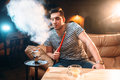 Young man smoking and relaxation at hookah bar Royalty Free Stock Photo