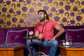 Young Man Smoking Shisha At Arabic Restaurant Royalty Free Stock Photo