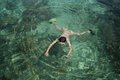 Young man snorkeling on the beautiful beach at karimun jawa island indonesia Royalty Free Stock Photos