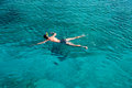 Young man snorkeling in blue sea caucasian Stock Images