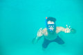 Young man snorkeling underwater portrait of a in a blue clean water Royalty Free Stock Images