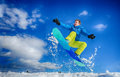Young man on the snowboard jumping over slope in winter Stock Photos