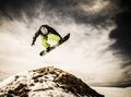 Young man snowboarder big air trick Stock Image