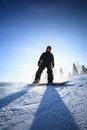 Young man snowboarding down a slope Royalty Free Stock Photography