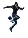 Young man soccer freestyler player silhouette one caucasian in on white background Stock Photos